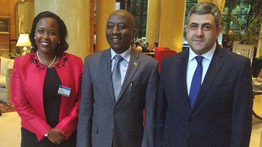 Prime Minister Edouard Ngirente (C) poses for a photo with RDB CEO Clare Akamazi and Zurab Pololikashvili the Secretary General of UN World Tourism Organisation. (Courtesy)