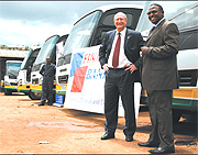 Steve Caley, the Fina Bank Rwanda boss and Col. (RTD). Dodo Twahirwa.