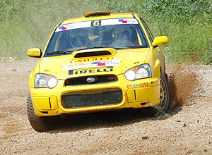 Giancarlo's Subaru negotiates a corner during last year's KCB Mountain Gorilla Rally. The national champion has vowed to up-stage Jamie Whyte in Uganda. (File Photo)