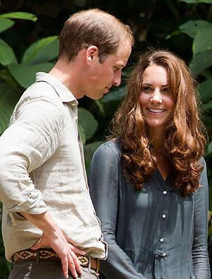 Britain's Prince William, left, and Kate, the Duchess of Cambridge speak to each other during their visit at the Borneo Rainforest Lodge in Danum Valley, some 70 kilometers (44 miles) west of Lahad Datu, on the island of Borneo Saturday. AP