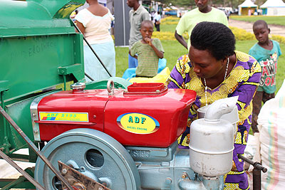 Devota Nsabamariya from Nyagatare District exhibits her maize grinding machine. The machine has a capacity of grinding 25 tonnes of maize in one day and costs Rwf 2 million.