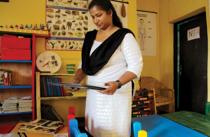Little Flowers School founder, Milcah Grace Aziz, in one of the classrooms.