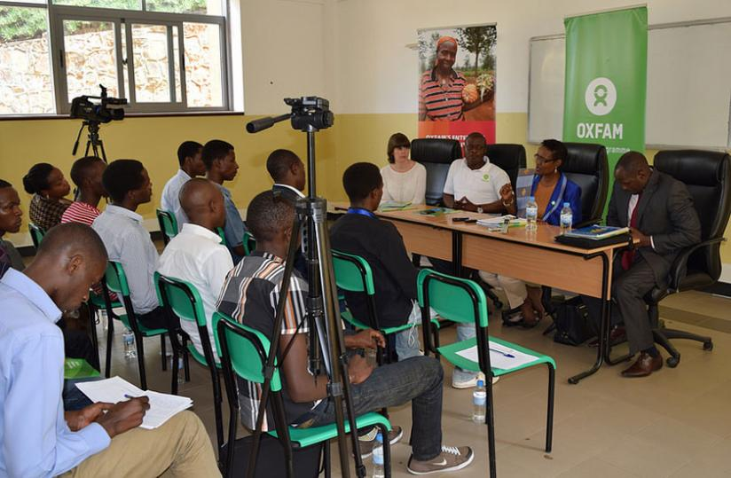 1463012872Executive-Director-of-Oxfam-International,-Winnie-Byanyima-(2nd-R)-addresses-the-media-in-a-press-conference