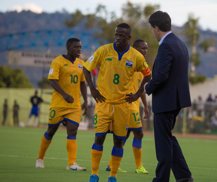1471512239McKinstry speaks to Amavubi captain Haruna Niyonzima during the 3-2 home defeat to Mozambique in the Group H 2017 AfCON qualifier in June. File.