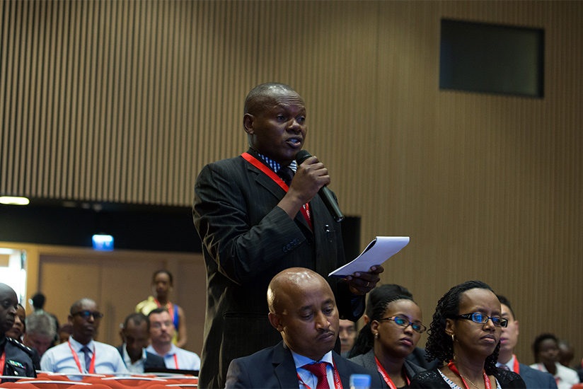 1487891393A-participant-asks-a-question-during-the-summit.-T.Kisambira