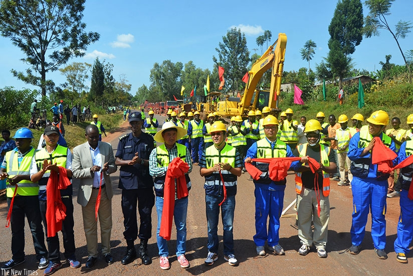 Officials and CRBC engineers launch the 92-kilometre Kayonza-Rusumo road rehabilitation and widening project in Kayonza yesterday. Sam Ngendahimana.