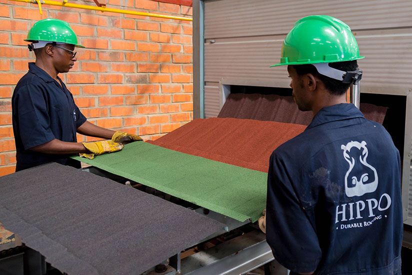 Employees of a stone-coated tiles-making firm monitor the production line. Manufacturing is key to ensure sustainable development. / File