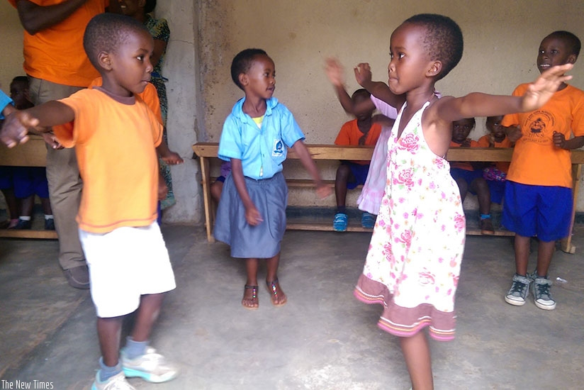 The cultural spirit. Aldrick (L) and Joy(R) practice the Igishakamba traditional  dance.