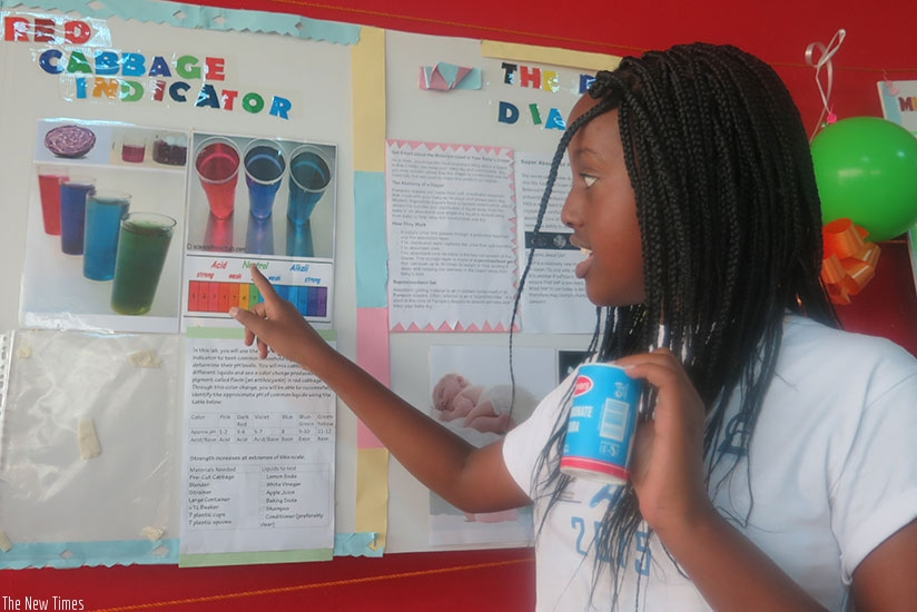 A student explains her project to an audience. Creativity promotes good ideas and smart learning. (Dennis Agaba)