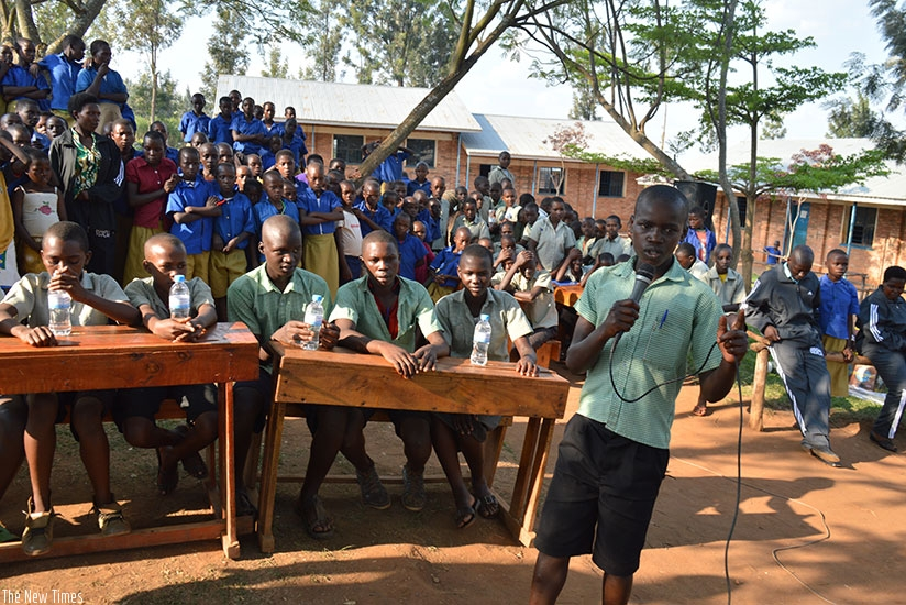 Pupils during a school debate. Working hard helps you to learn more and become smarter. / Dennis Agaba.
