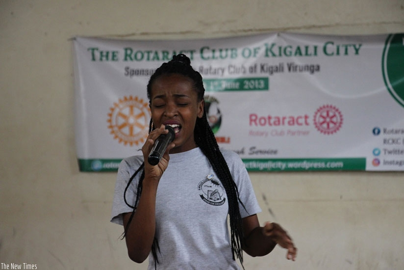 A student singing at the talent show. (Photos by Francis Byaruhanga)