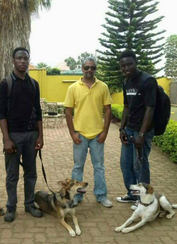 El Rahim Jaffer (centre) with some of his dog trainers.  / Jean de Dieu Nsabimana