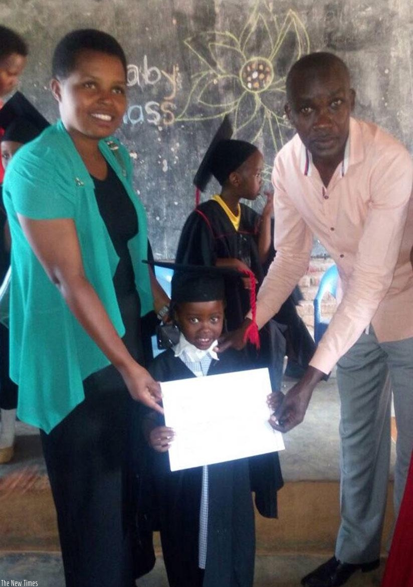 A pupil with her mother and teacher on graduation. Children should make their parents proud by performing well. (D. Agaba)