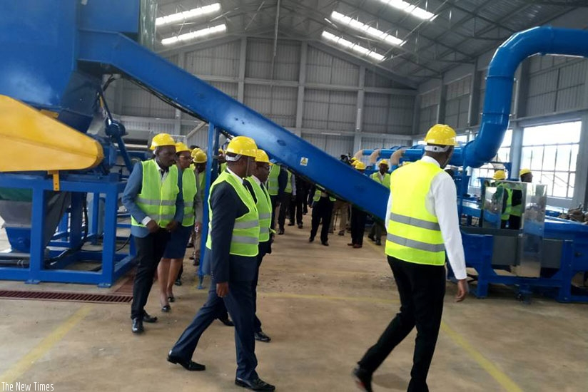 Officials tour the e-Waste recycling and dismantling facility in Bugesera (Photos by Jean d'Amour Mbonyinshuti)
