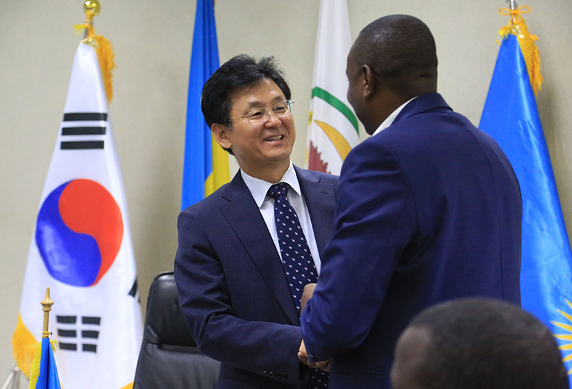 1512717754Isaac-Munyakazi,-the-State-Minister-for-Primary-and-Secondary-Education-greets-Kim-Eung--Joong-Ambassador-of-the-Republic-of-Korea