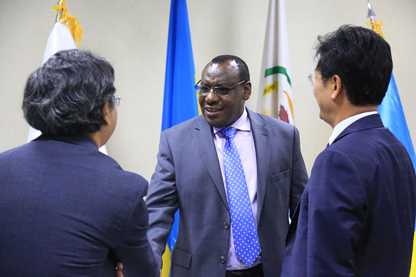 1512718124Minister-for-Finance-and-Economic-planning-Claver-Gatete-chats-with-Korean-diplomats-before-the-signing