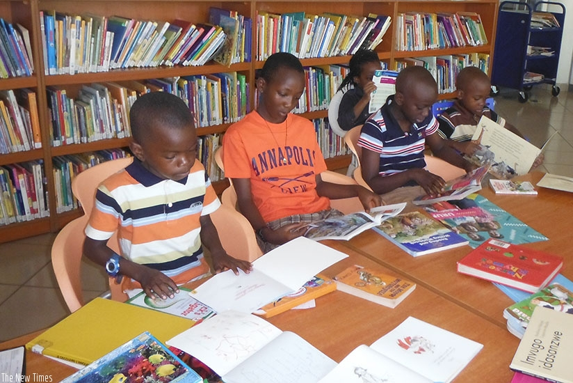 Children read story books in a library. Let this holiday also be a moment to share with your colleagues stories that you have read. Inspire others to read. (Dennis Agaba)