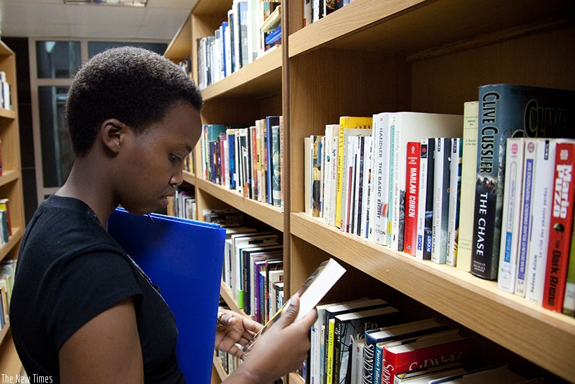 A student looks for a textbook at the public library in Kigali. (Timothy Kisambira)