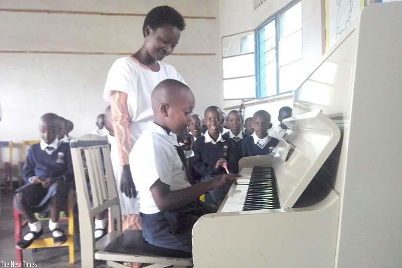 Children learn how to play a piano. Make it your goal to learn a new skill this year.  (Dennis Agaba)