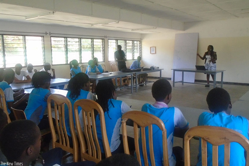 A mentor talks to students about the importance of setting goals and developing a work-plan.  (Lydia Atieno)