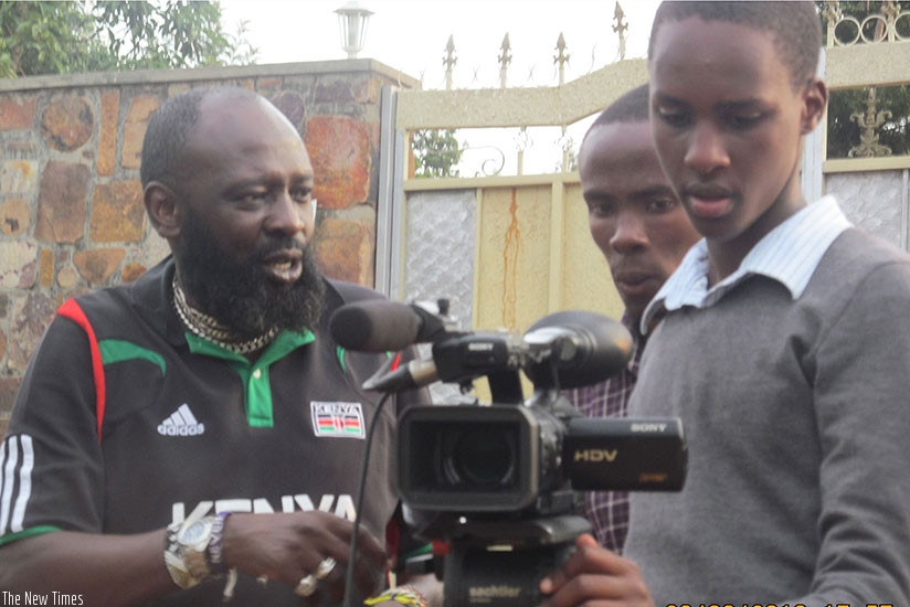Samuel Ishimwe Karemangingo (R) with a film crew at the set. (Courtesy photos)