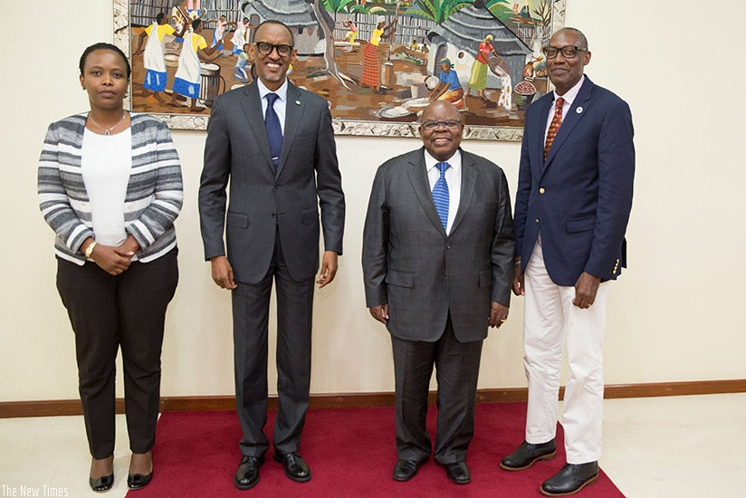 President Kagame in a group photo with Co-Chair of Africa Wildlife Foundation (AWF) Board Benjamin Mkapa; AWF president Kaddu Sebunya (right); and the chief executive of Rwanda Dev....