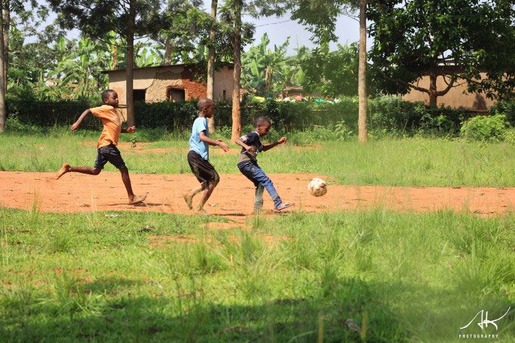 1516454392Children-in-the-countryside-playing-football