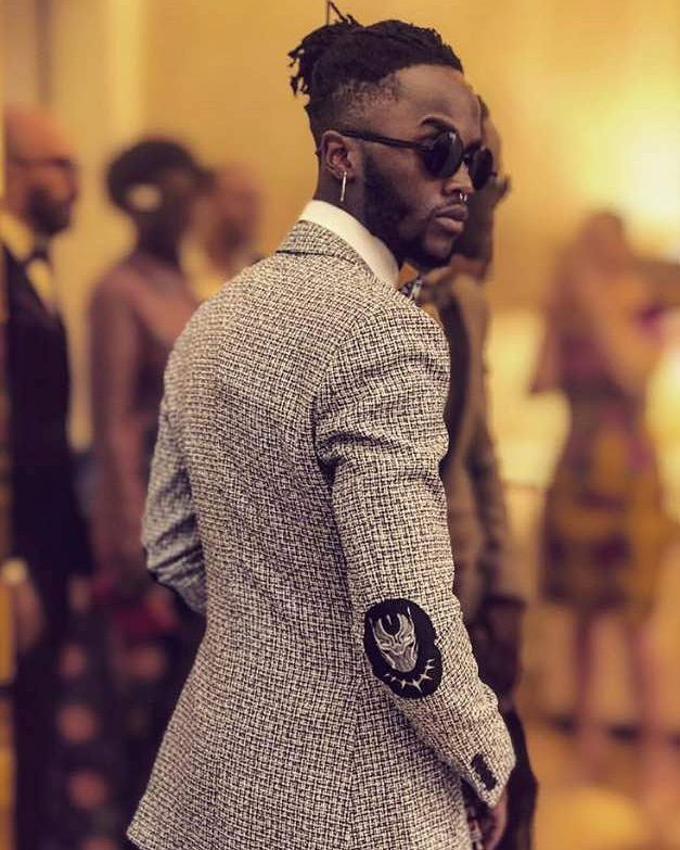 Nyong'o opted for a three piece suit of black contrast lapels and wax print lining by Rwandan designer Matthew Rugamba, for Black Panther's star-studded world premiere, Monday nigh....