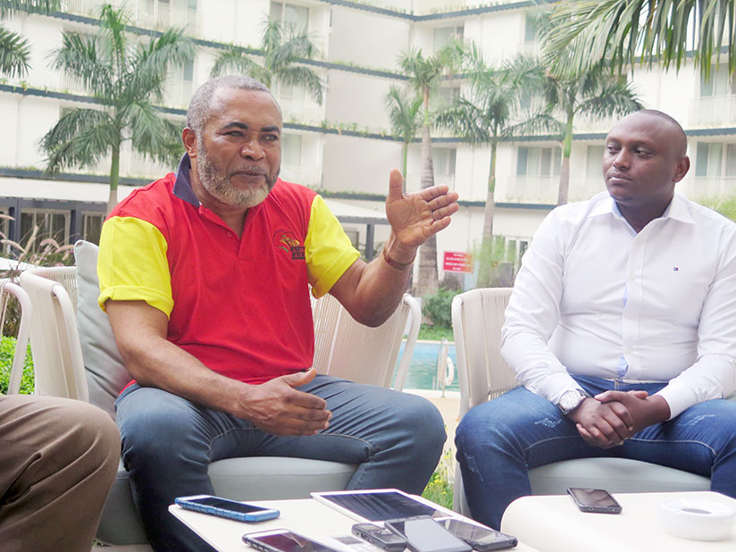 Nigerian film producer and director, Orji Zachee Ama (left) speaks to the media last week during a news conference in Kigali. Looking on is Willy Ndahiro, the director of Hillywood....