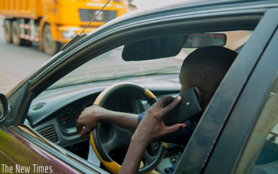 Rwanda National Police recently announced new stringent fines for drivers caught using mobile phones while driving. Faustin Niyigena.
