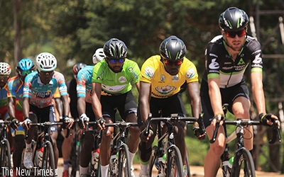 Rwandan rider Joseph Areruya (in yellow jersey) leads a peloton during stage six of Tour du Rwanda last year. The youngster went on to win the annual race and has since won two oth....
