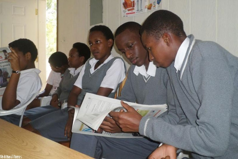 Students reading in a group. Group activities make the learning experience richer and more enjoyable.  / Lydia Atieno.
