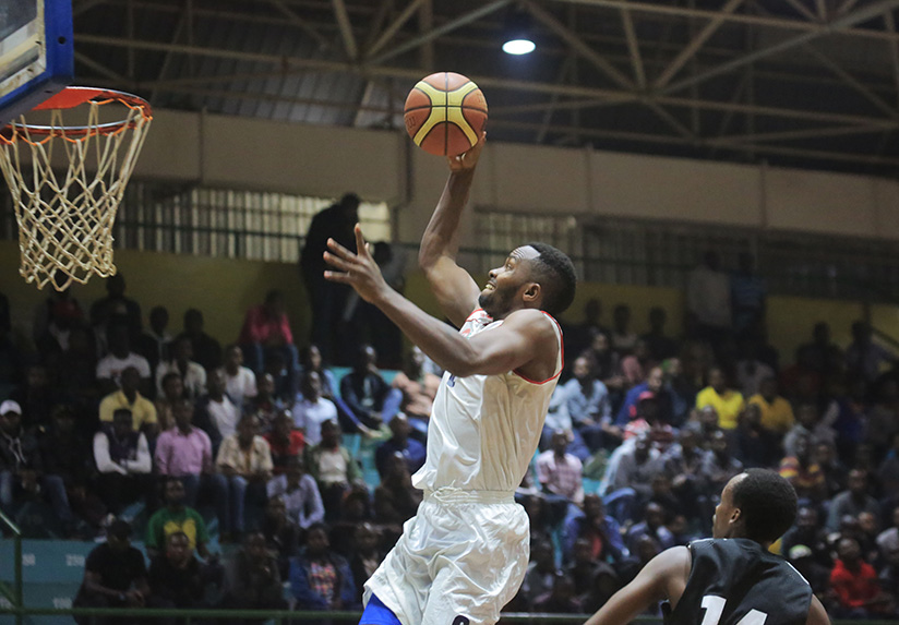 1521322007REGs-Nkurunziza-finishes-off-a-stylish-lay-up-during-a-game-against-APR-BBC