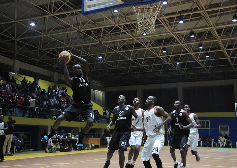 1521321547Parfait-Ishimwe-in-the-air-with-the-ball-finishes-off-a-stylish-lay-up-during-a-game-against--REG