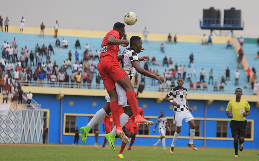 1521322705APR-FC-striker-Nshuti-Innocent-scores-the-second-goal,-seen-here-in-action-with-Youssouf-Maiga-during-the-match