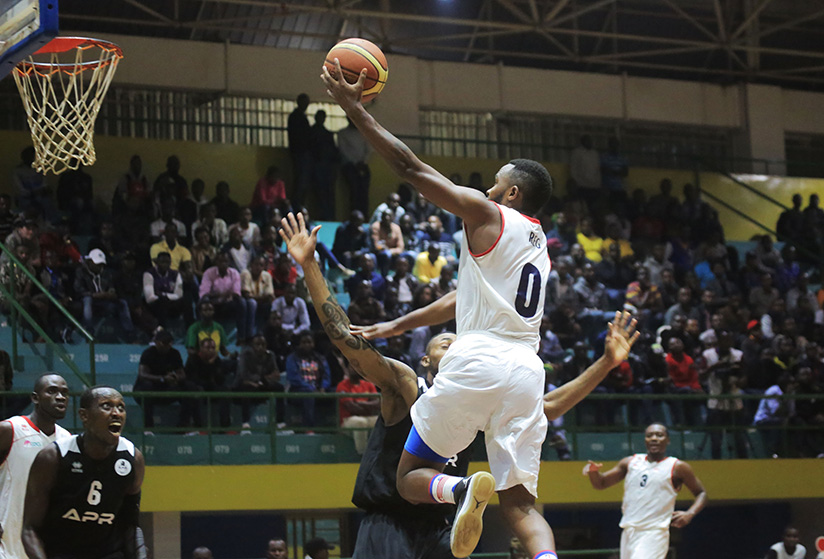 1521321481Nkurunziza-0-of-REG-dunks-against-APR-during-the-game-at-Amahoro-indoor-Stadium-on-Friday