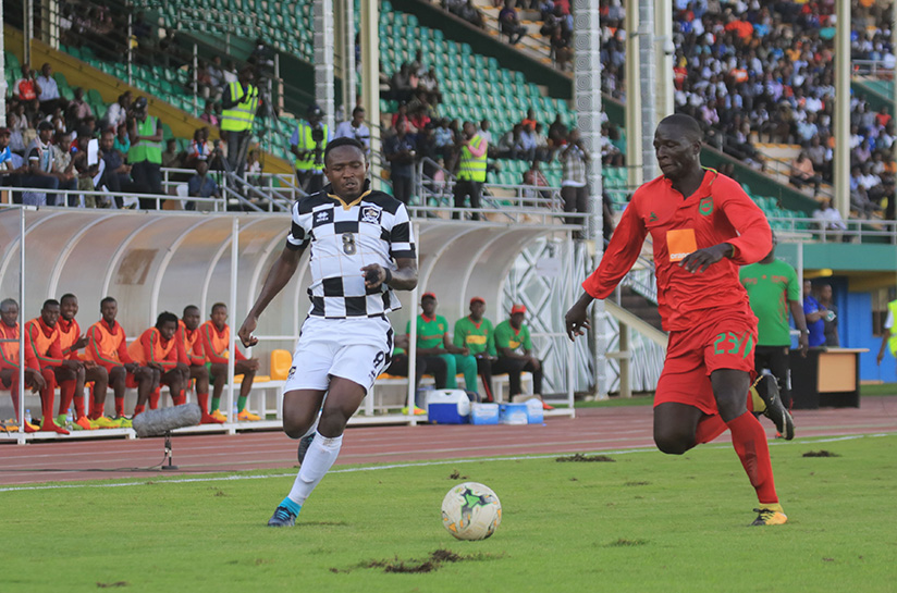 1521322899Djihad-Bizimana-scores-the-equalizer-,-captured-here-in-action-with-Oumar-Kida-during-the-match