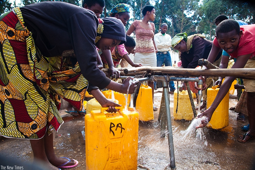 Residents of Karongi draw water. Rwanda will join the rest of the world to mark International World Water Day on Thursday. File.