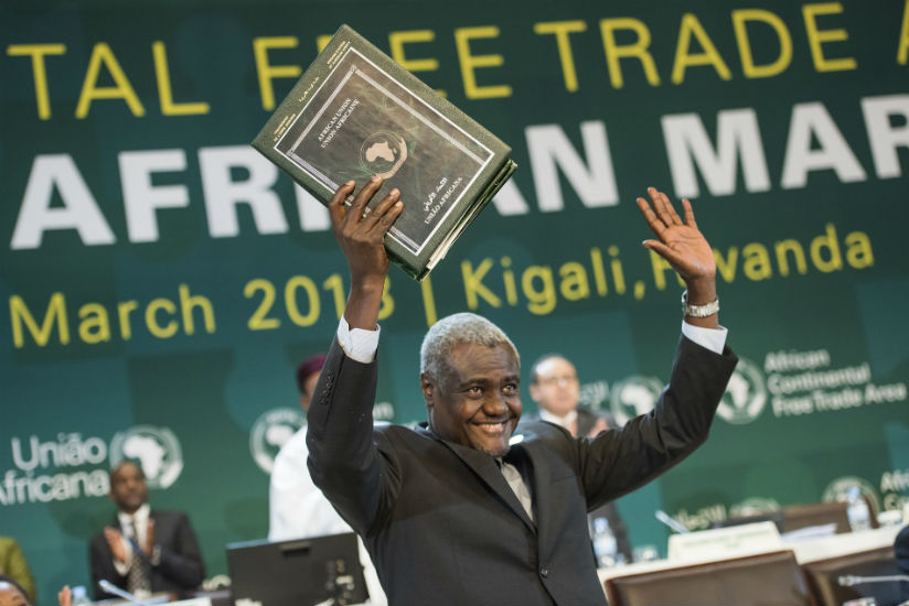 The Chairperson of the African Union Commission Moussa Faki Mahamat holds the instruments after they were signed by the heads of state and representatives from various African coun....