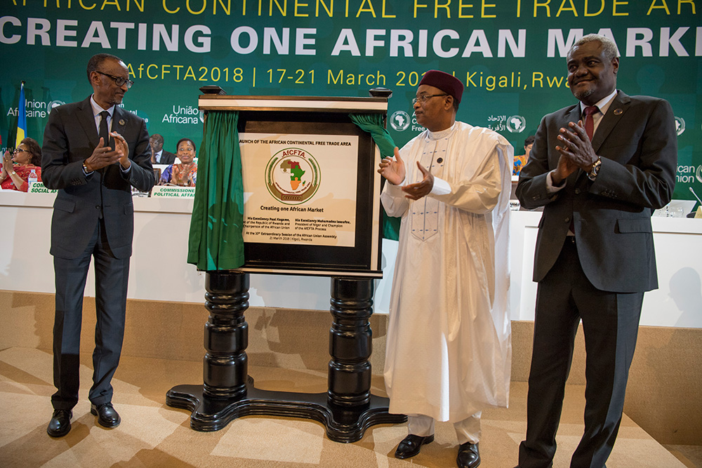 The Chairperson of the African Union, President Paul Kagame; the Champion of the African Continental Free Trade Area, President Mahamadou Issoufou of Niger; and the Chairperson of the African Union Commission, Moussa Faki Mahamat (right), applaud after unveiling a plaque marking the official launch of CFTA at Kigali Convention Centre on Wednesday.  The signing of the instrument by 44 countries paves the way for yet another critical stage geared at bringing CFTA into force. / Village Urugwiro.