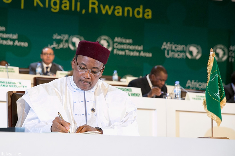 President Mahamadou Issoufou of Niger, who spearheaded the CFTA adoption process, was the first leader to sign the agreements in Kigali yesterday.  Courtesy.