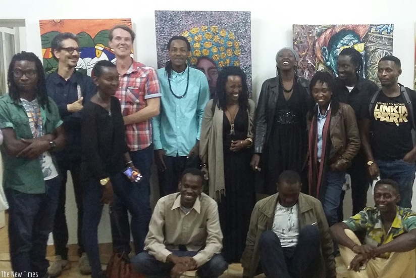 Some of the exhibiting artists pose for a group photo at Goethe Institut Kigali. /All photos by Moses Opobo.