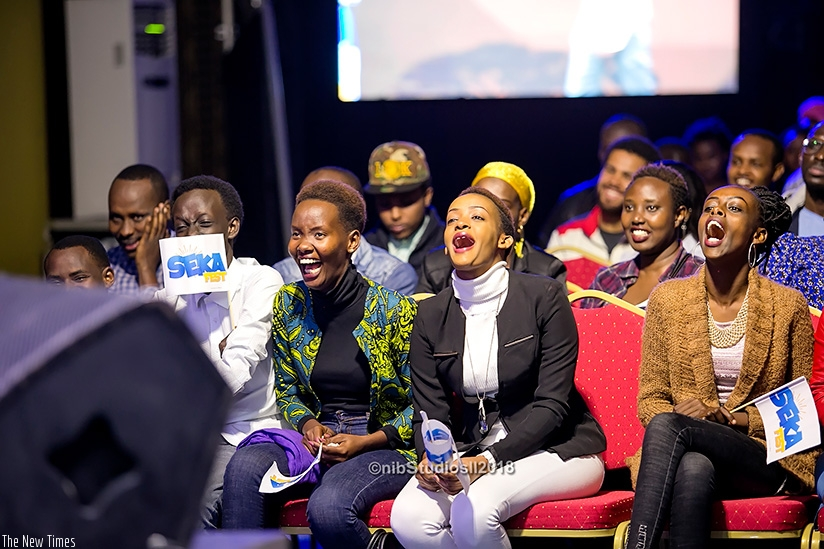 The audience laughing and enjoying stand-up comedians at the festival. / Photos courtesy of Nib Studio