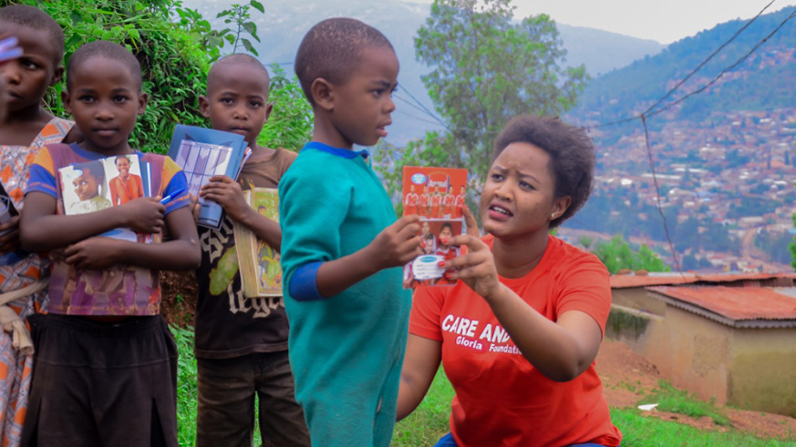 Gloria Gatsinzi provides vulnerable children with scholastic materials. / Courtesy