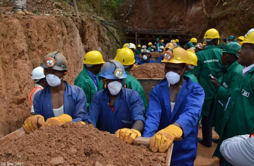 Miners leaving a tunnel at Rutongo Mines in Rulindo District. / File