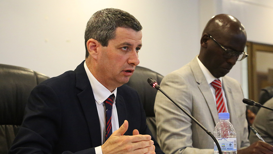 Rwanda Energy Group Chief Executive Officer Ron Weiss addresses members of the parliamentary Public Accounts Committee as Jean-Claude Kalisa, the managing director of EUCL, takes notes. / Sam Ngendahimana