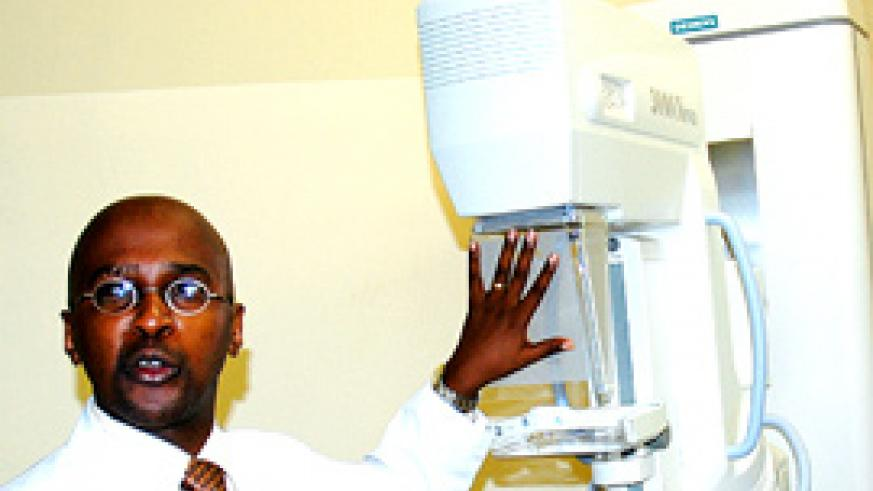 Dr. Uwimana explaining features of the newly acquired mammography machine yesterday. (Photo/ J. Mbanda)