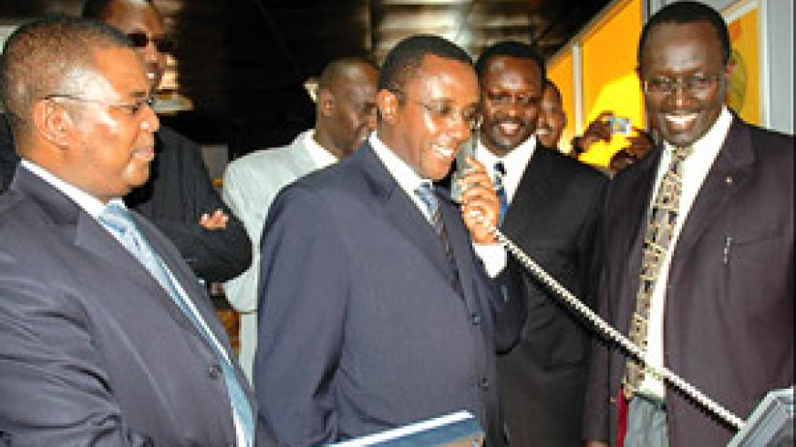 Senate President Dr Vincent Biruta tries out a videophone which will soon be introduced by MTN Rwanda on the local market. He was touring the ongoing expo at Gikondo Expo Grounds in Kigali before opening it yesterday. Left is MTN Rwanda Chief Executive Of