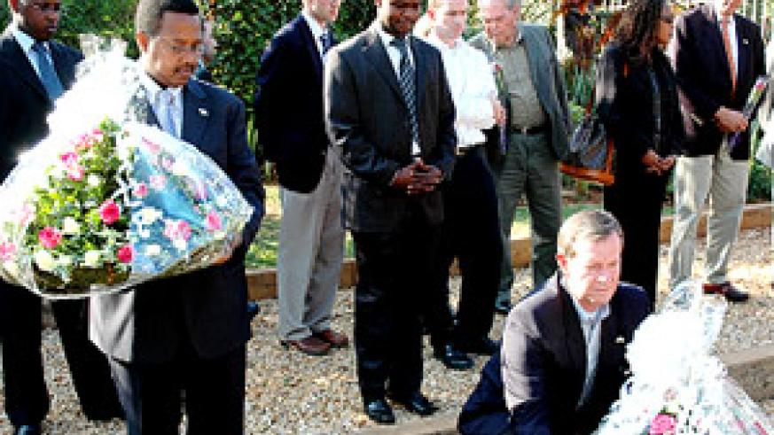 US' Leavitt laying a wreath at Kigali Genocide Memorial Centre yesterday while State Minister for HIV/Aids and other Infectious Diseases, Dr Innocent Nyaruhirira (left), gets ready to honour Genocide victims. (Photo/ J. Mbanda)