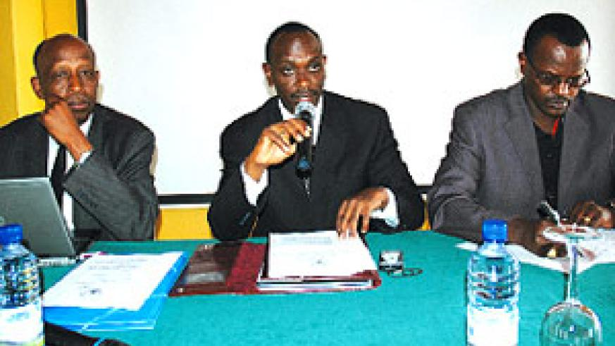 Sezibera (C) speaking during the conference yesterday. Left is the Secretary General in the Internal Security ministry, Joseph Mutaboba while the other is George Mupenzi, Chairperson of Civil Society Platform. (Photo/J. Mbanda)
